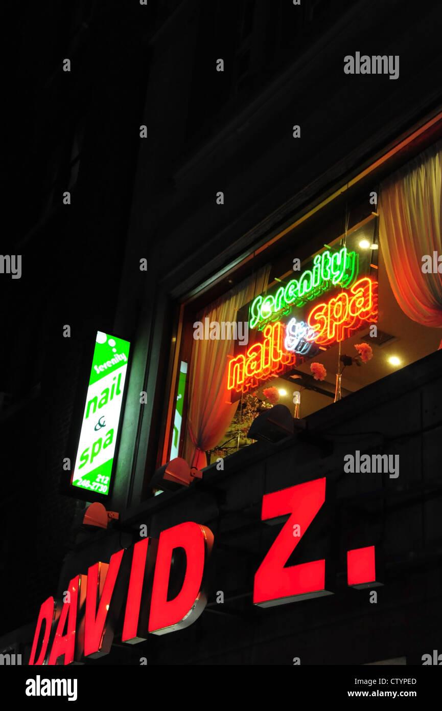 Night portrait red green electric neon signs \'David Z.\' shoe shop ...
