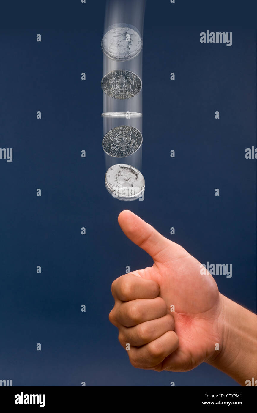 Flipping half dollar in air. - Stock Image