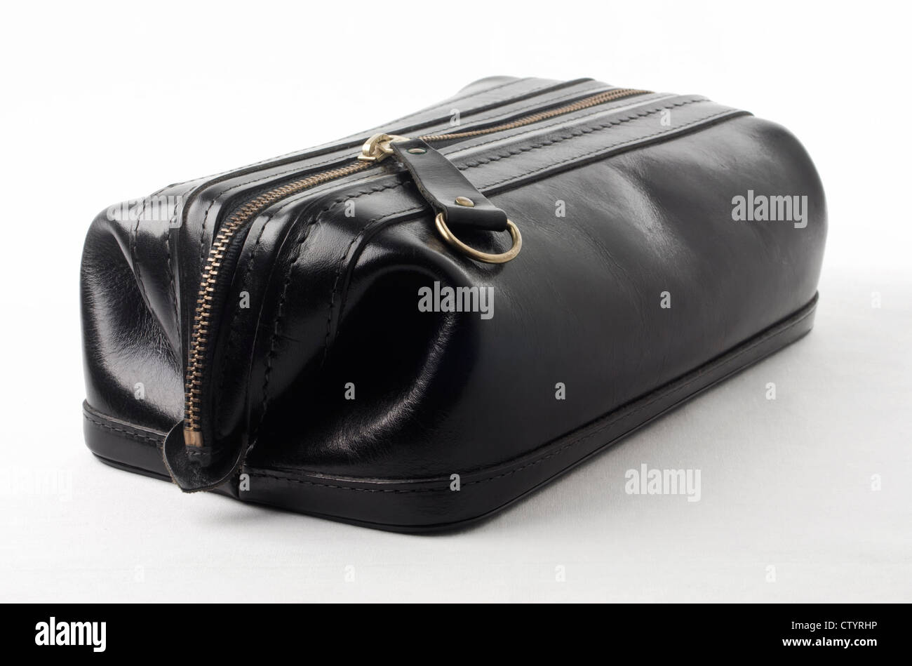 Man's black leather cosmetic toiletry accessory bag or pouch isolated on white background with copy space. - Stock Image