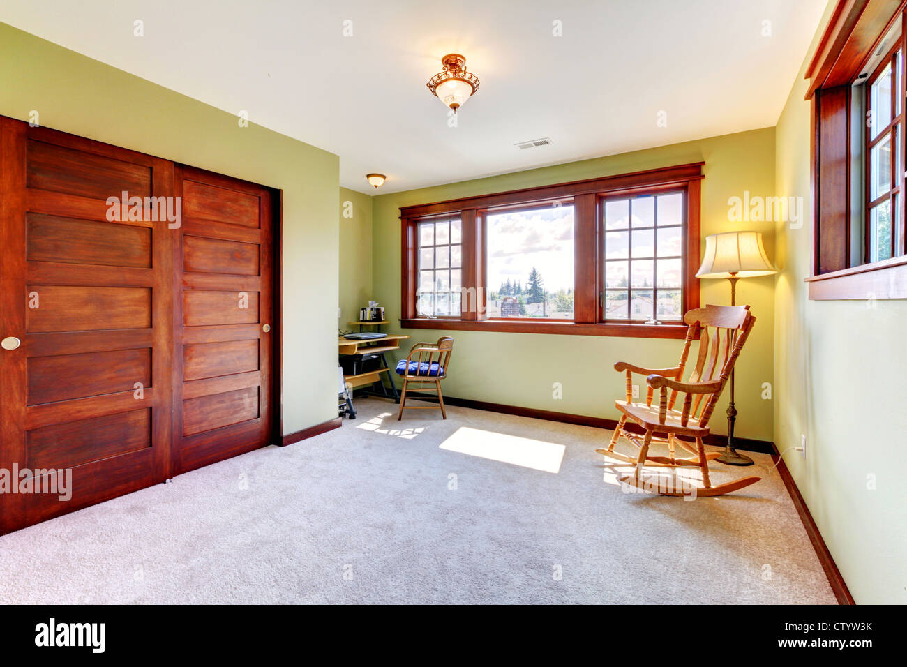 Nice Empty Bedroom With Two Windoows And Wood Closet Doors And Green