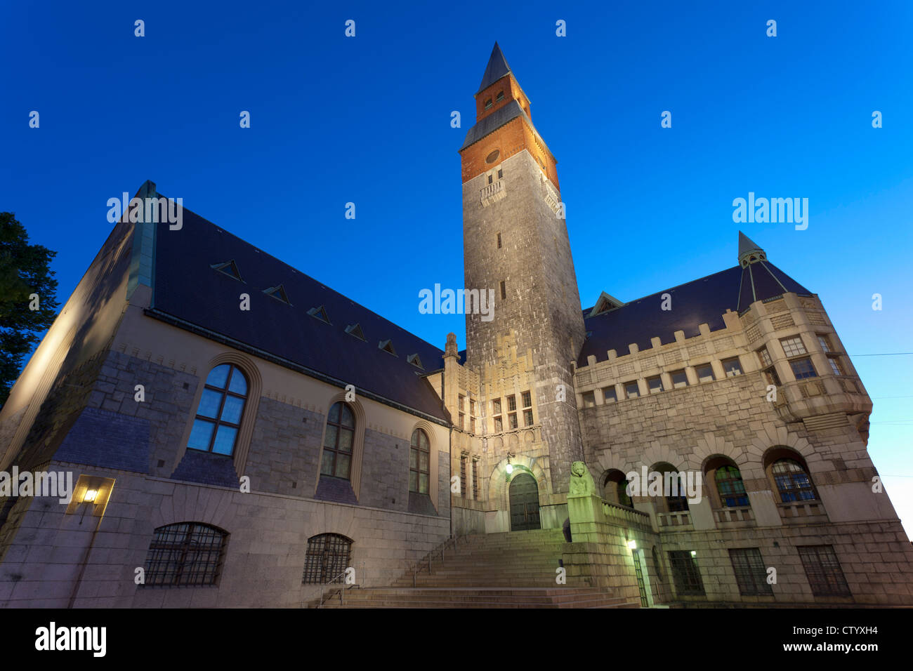 Stone building lit up at night - Stock Image