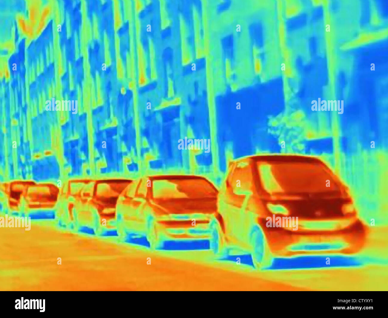 Thermal image of parked cars on street - Stock Image