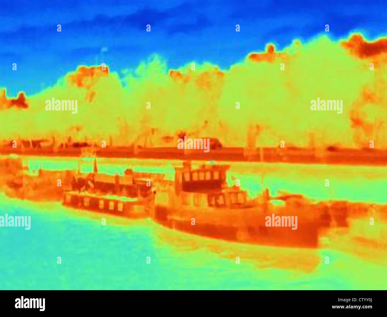 Thermal image of boats on urban river - Stock Image