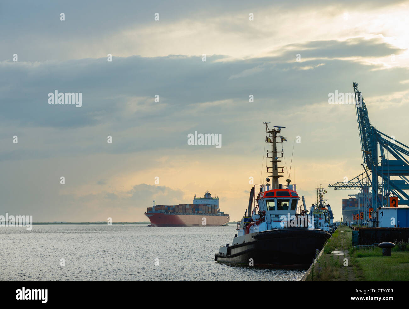 Ships docked in urban bay - Stock Image
