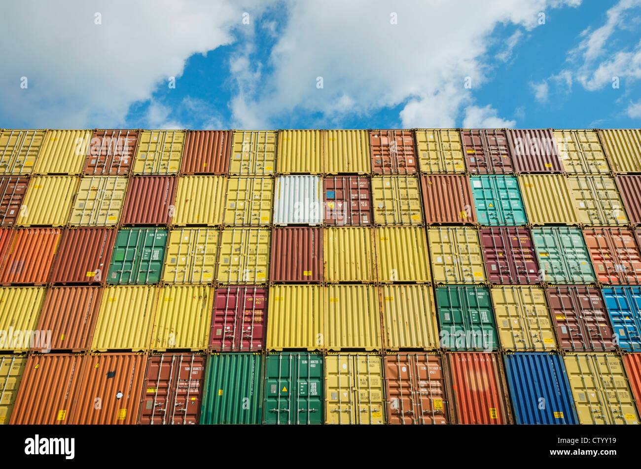 Shipping containers stacked together - Stock Image