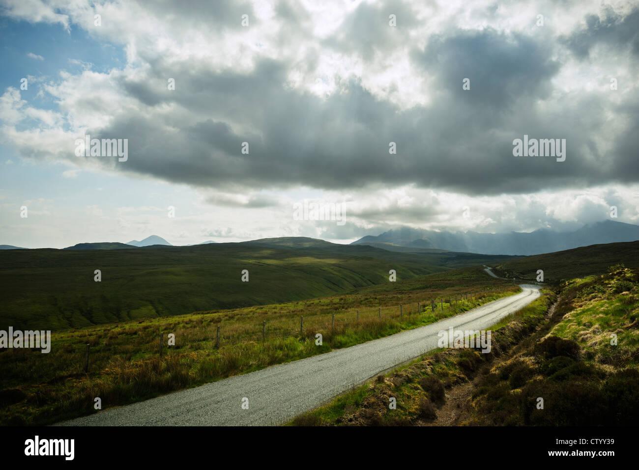 Gravel road in rural landscape - Stock Image
