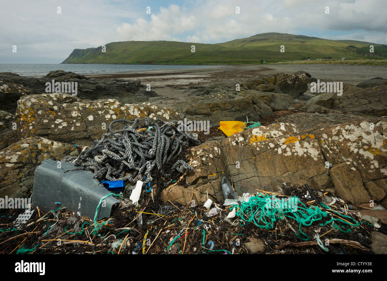 Sea landscape with plastic waste on the shore - Stock Image