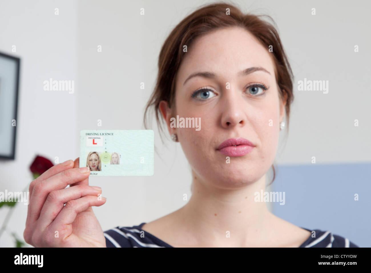 woman holding identification card stock photo 49786741 alamy
