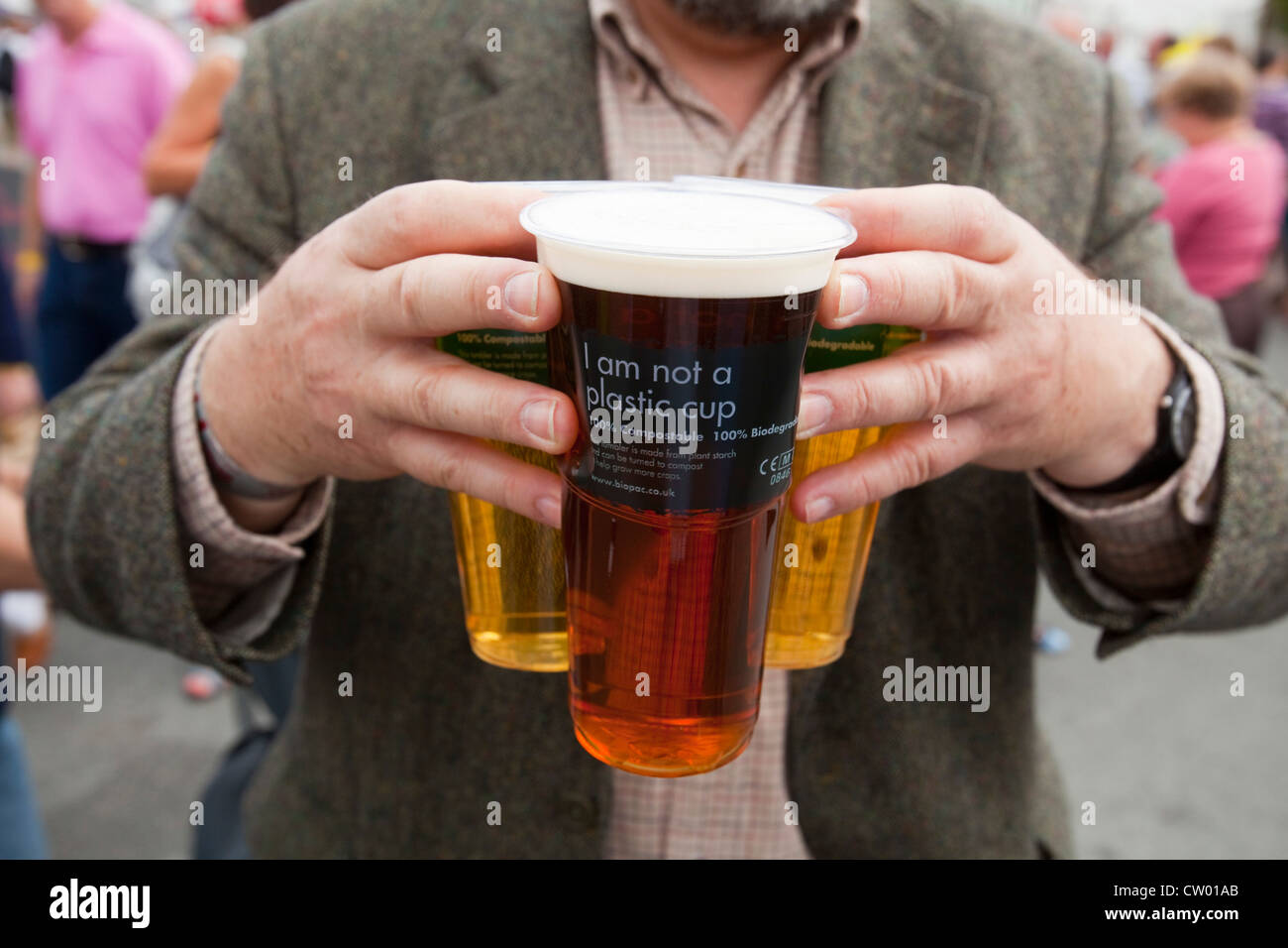 Man carrying pints of beer at Abergavenny Food festival, Monmouthshire, Wales, UK - Stock Image