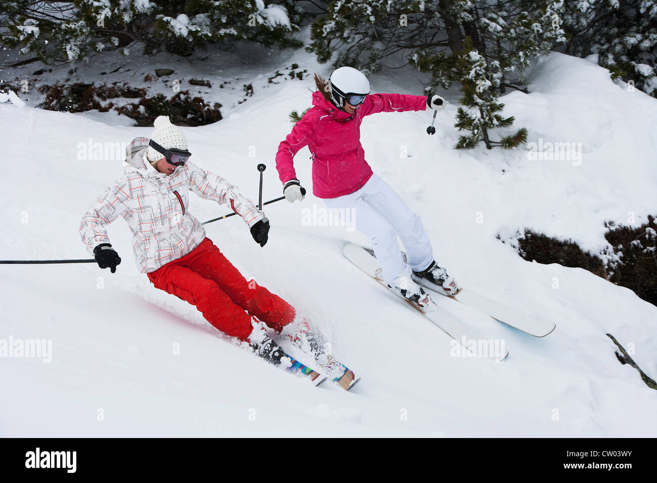 Skiers coasting on snowy slope - Stock Image