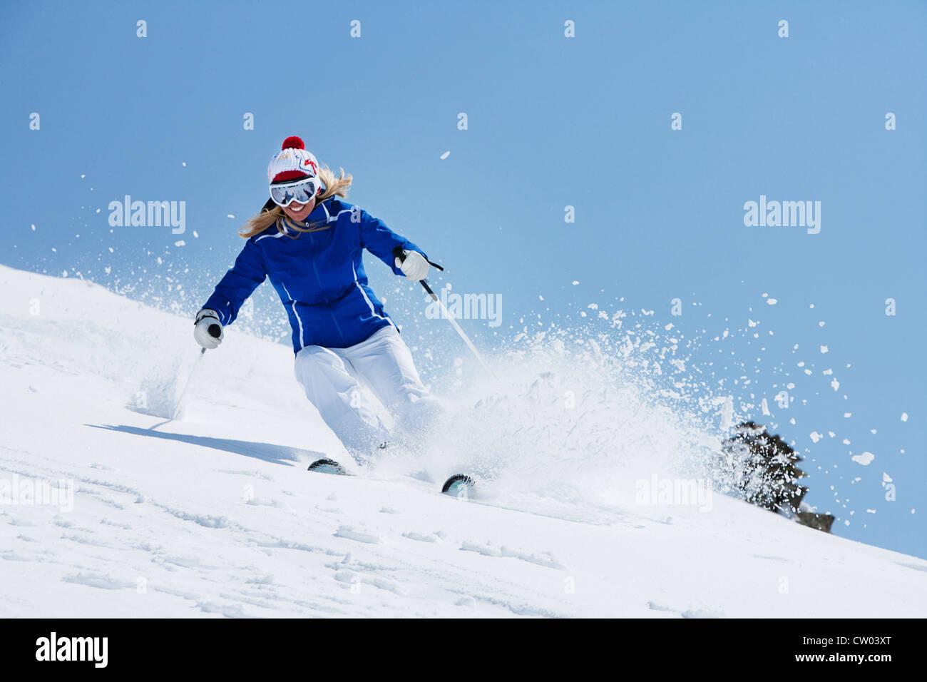 Skier coasting on snowy slope - Stock Image