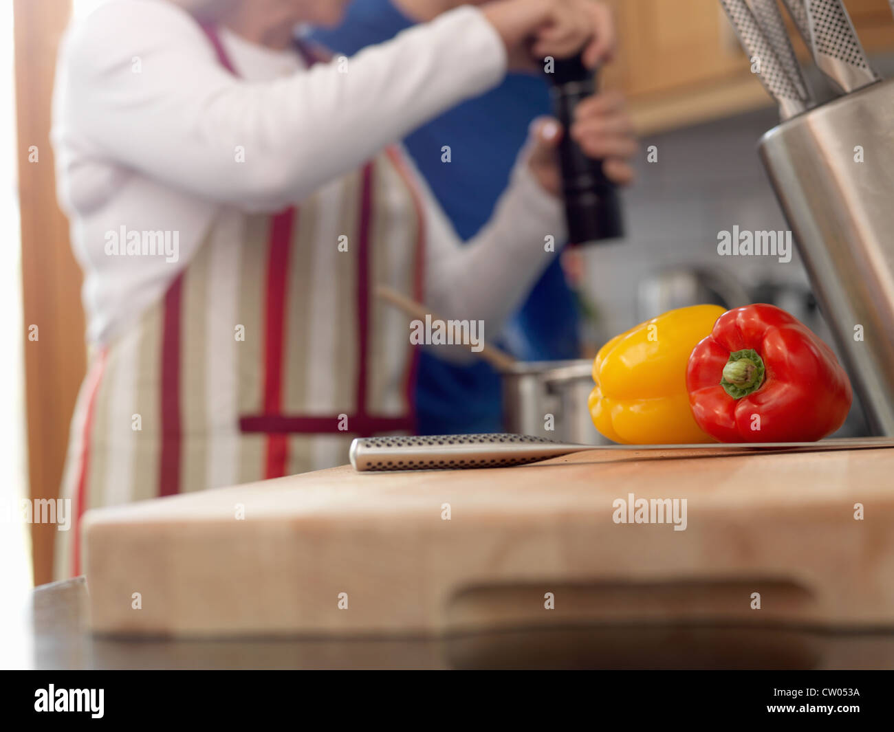 Close up of peppers on cutting board - Stock Image