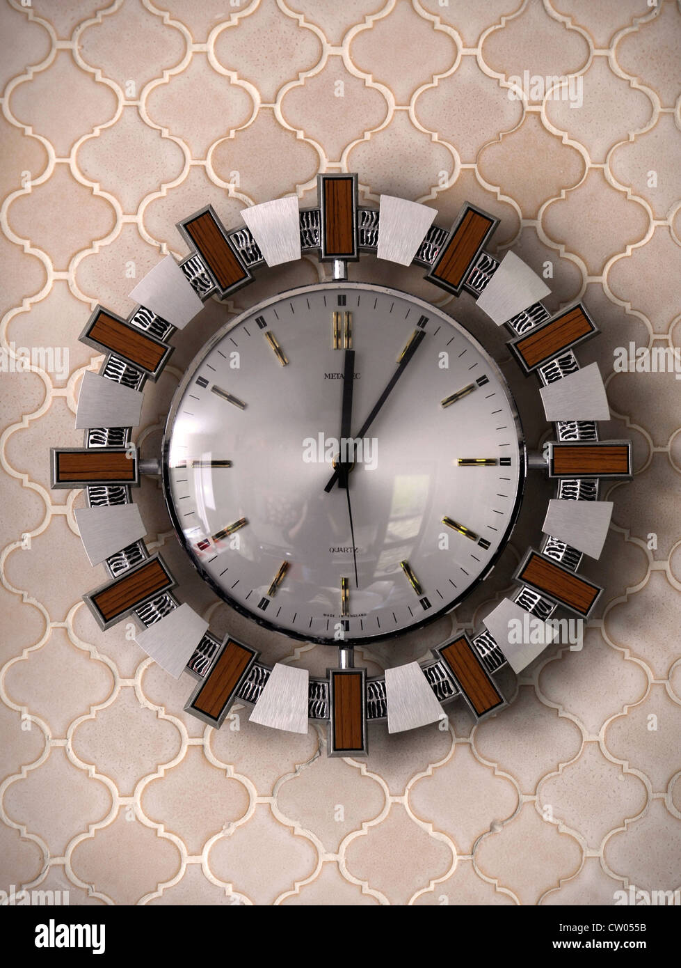 A clock in 1970's style house which was featured in a 1975 magazine makeover UK - Stock Image