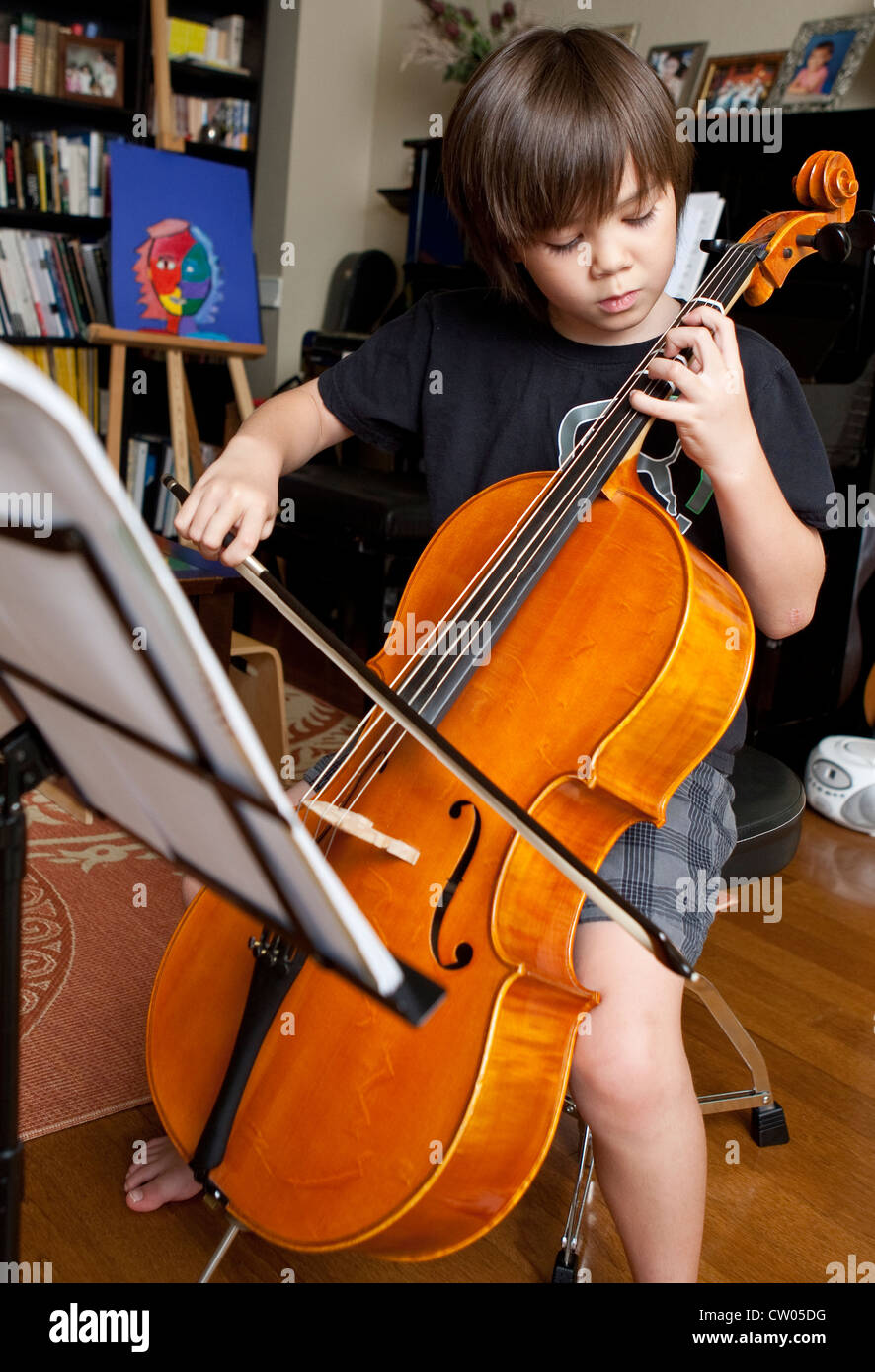 Japanese-American 8 year old boy practices music lessons