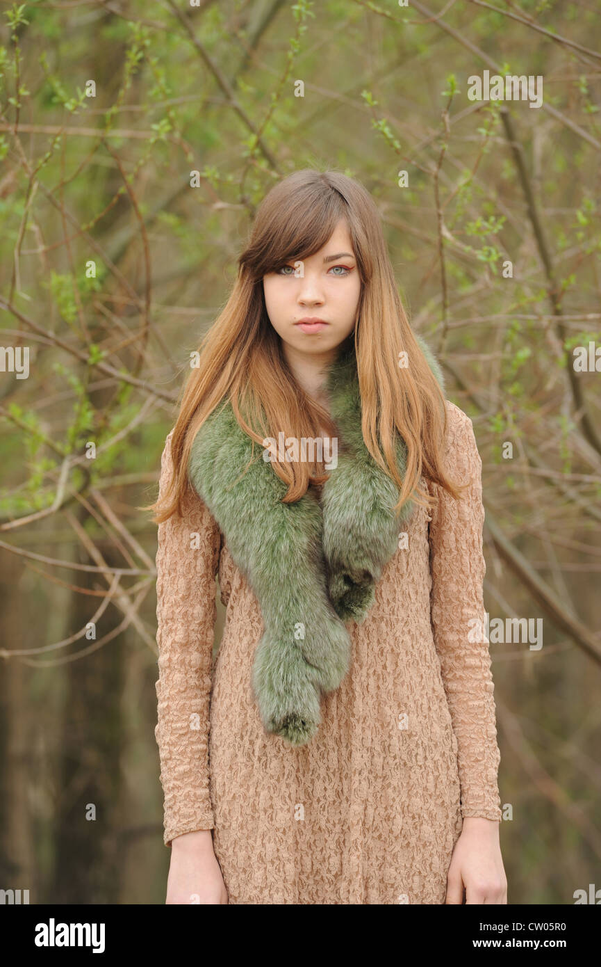 Teenage girl wearing fur scarf outdoors - Stock Image