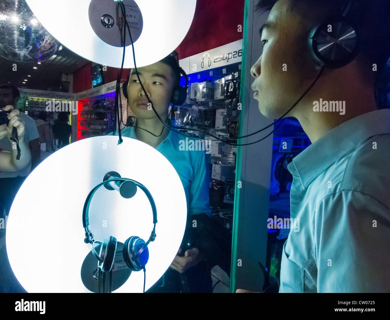 Paris, France, Young Chinese Man Shopping inside Virgin Megastore, Media Technology,Listening to Music on Headphones - Stock Image