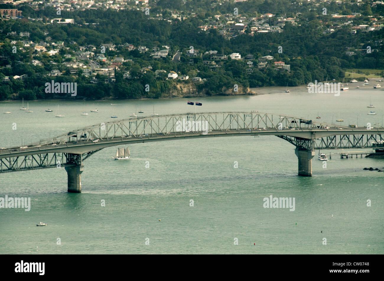 Auckland Harbour Bridge across Waitemata Bay in Auckland, New Zealand - Stock Image
