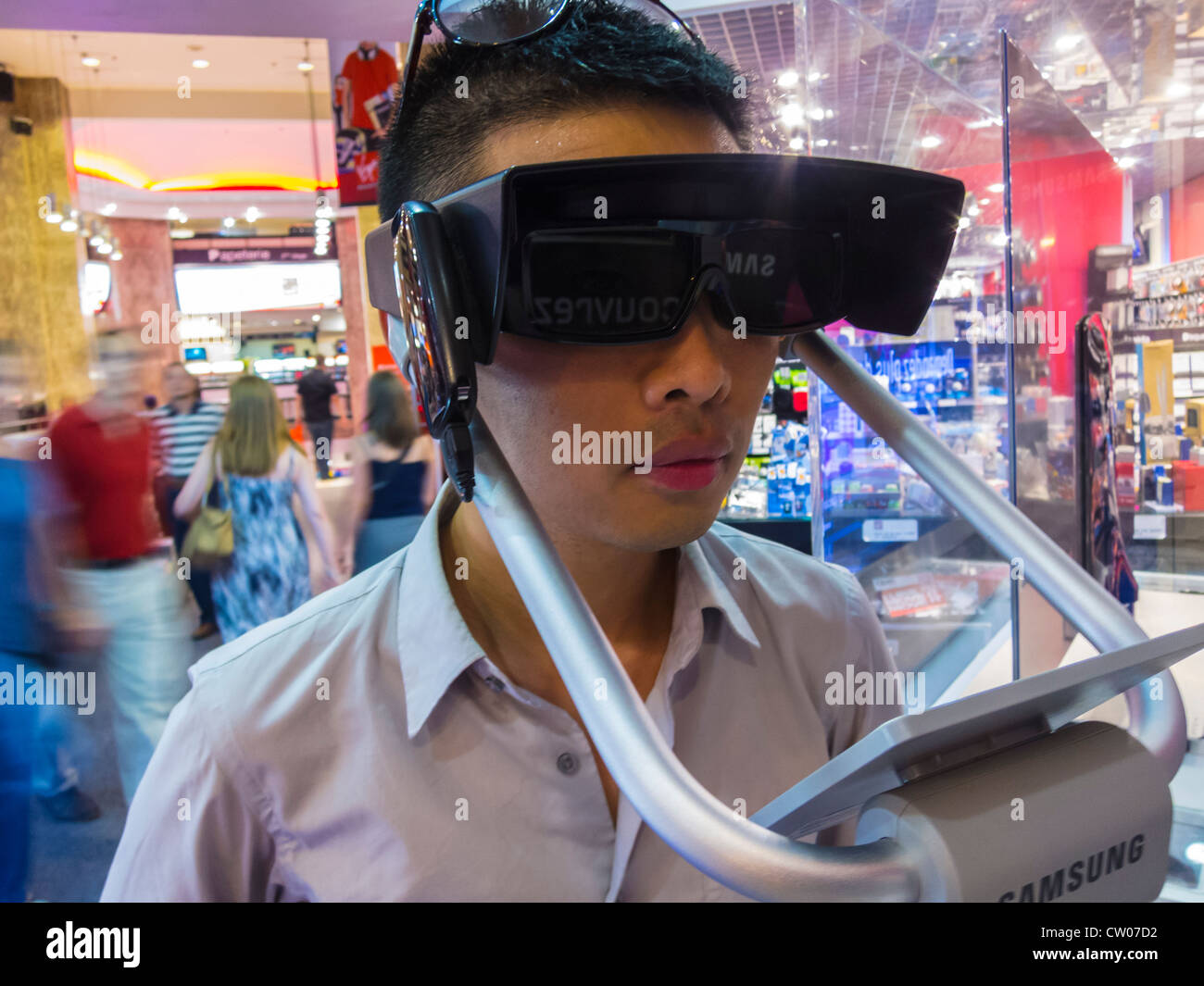 Paris, France, Detail, Chinese Man Using Three Dimensional Glasses 3D for High Definition T.V. in VIrgin Store, - Stock Image