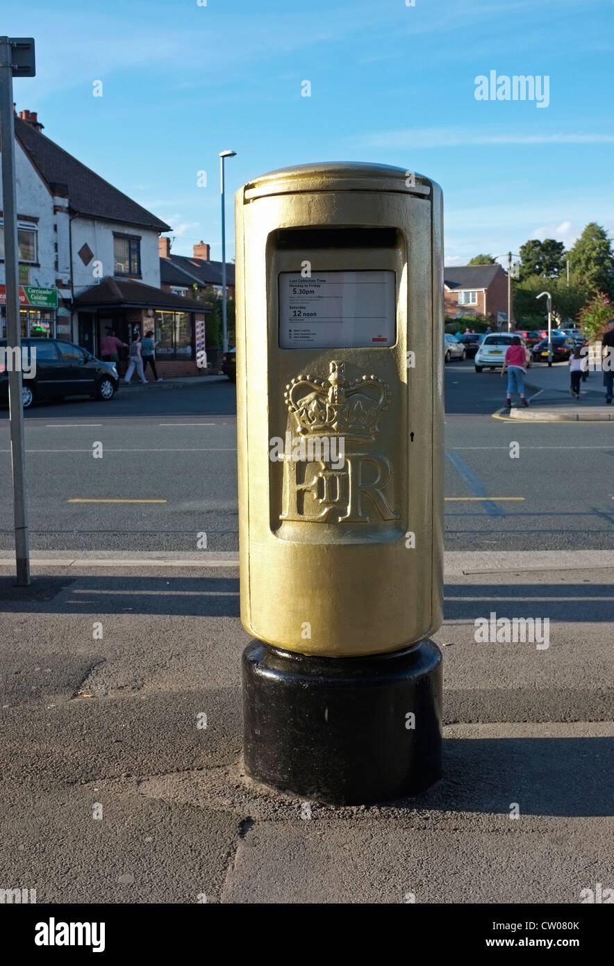 Gold Post Box in New Road Side, Horsforth, Leeds, where Alistair Brownlee lived.  Celebrates his Gold Medal in 2012 - Stock Image