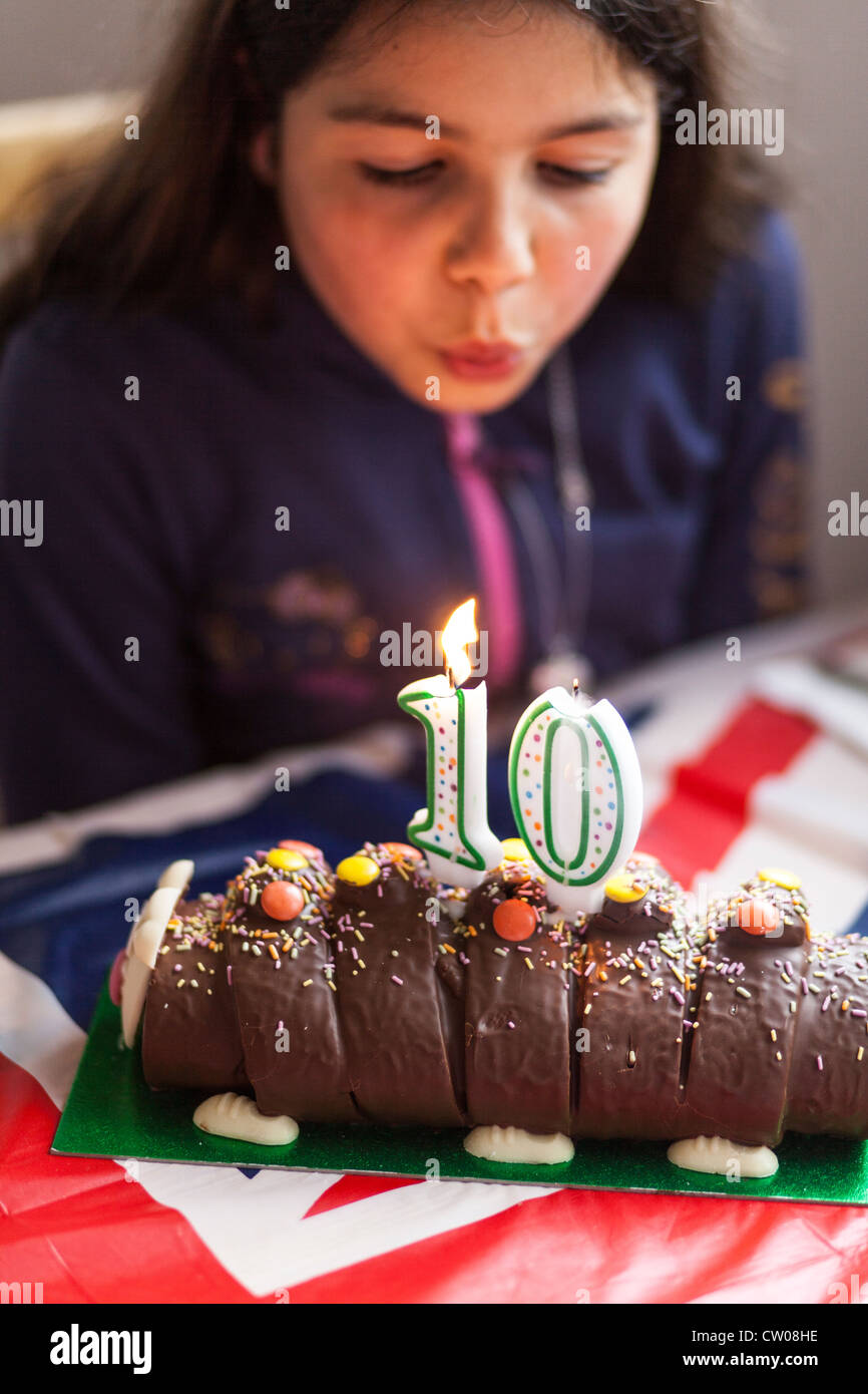 Phenomenal Ten Year Old Girl Blowing The Candles On Her Birthday Cake Stock Birthday Cards Printable Giouspongecafe Filternl
