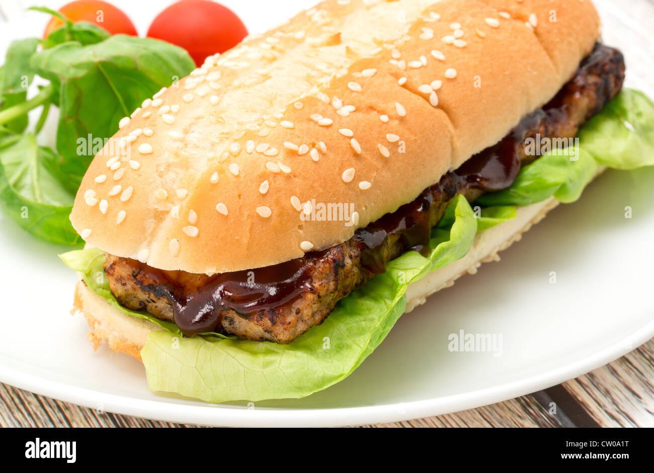 BBQ spare rib burger sandwich close-up - studio shot - Stock Image
