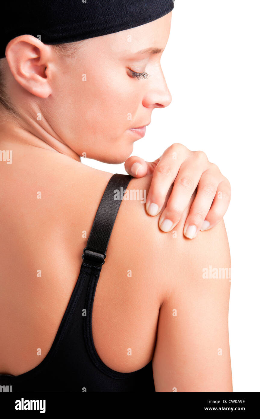 Young woman with pain in her shoulder - Stock Image