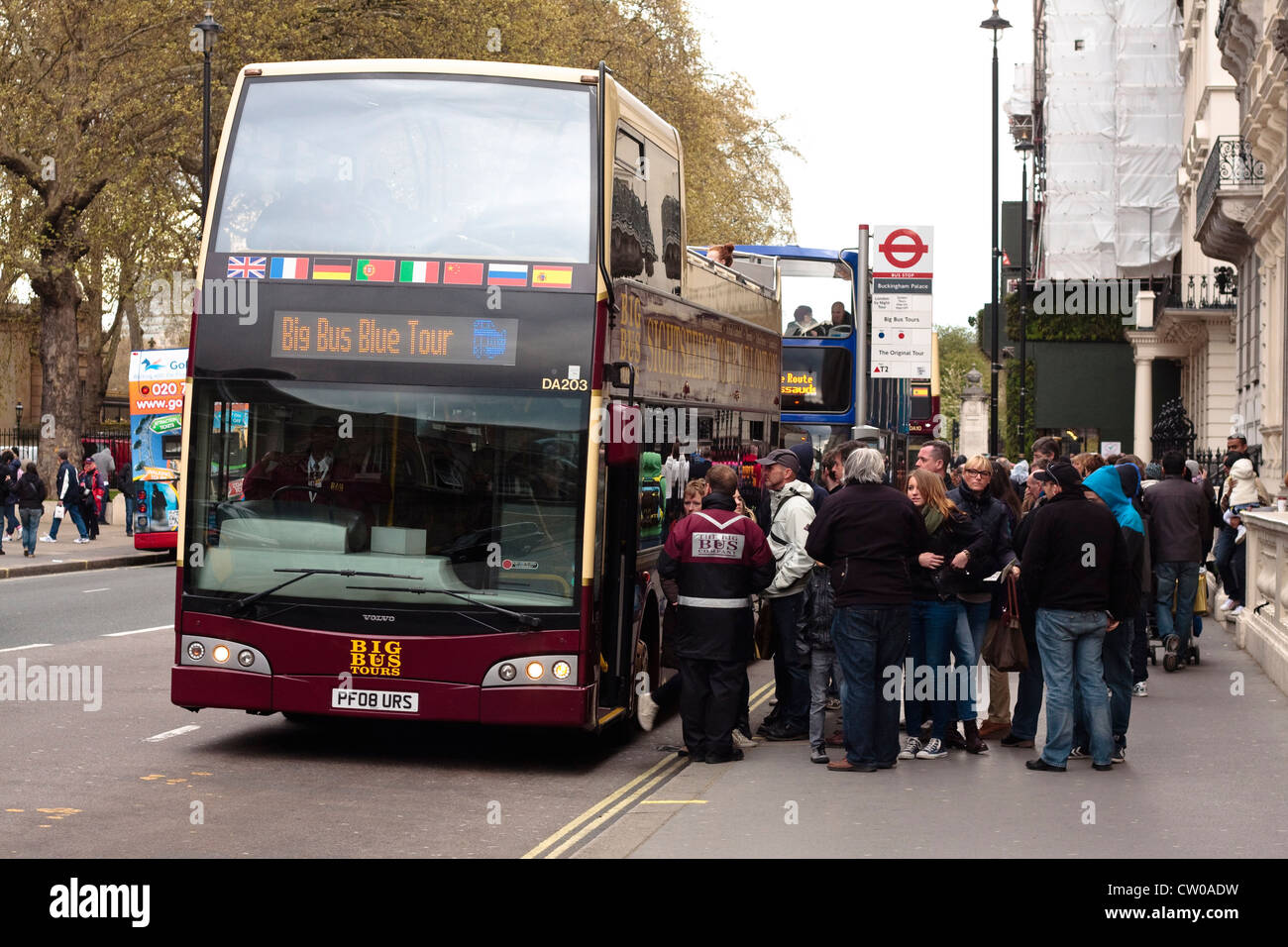 A parked Big Bus Tours bus with passengers getting ready to embark. London, UK - Stock Image