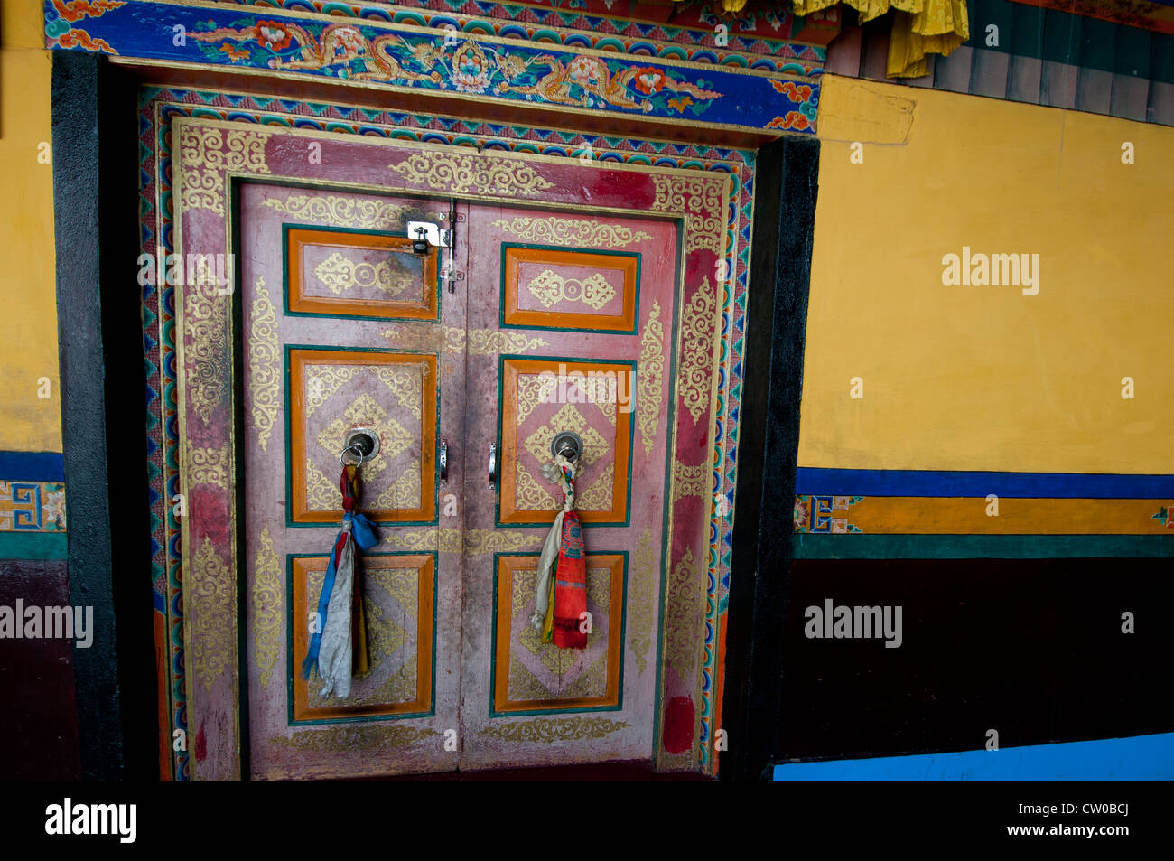 Colorfully painted door with traditional decorations at Shey Palace & Monastery near Leh, Ladakh, India. - Stock Image