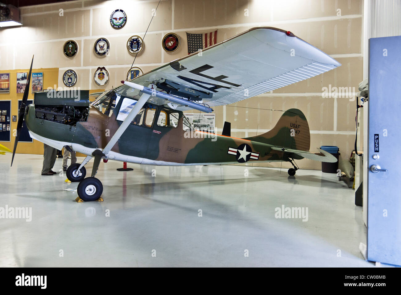 Cessna 172 0-1 observation prop plane used during Korean conflict for front line communication museum display camouflage - Stock Image