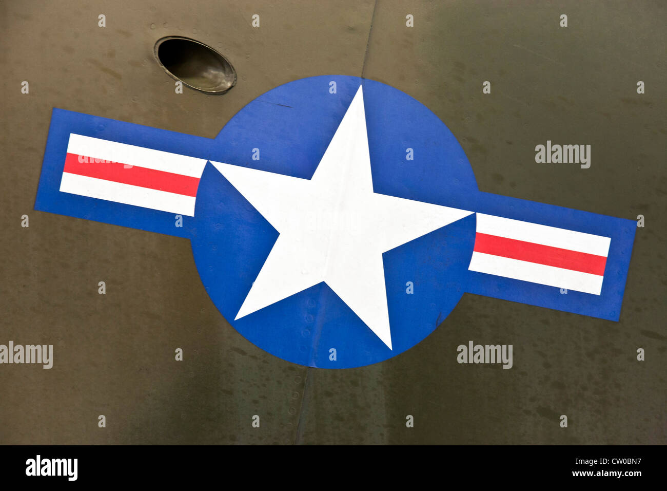 US Navy military aircraft logo roundel over camouflage paint on side of Douglas A-1 proud American Korean War skyrider - Stock Image