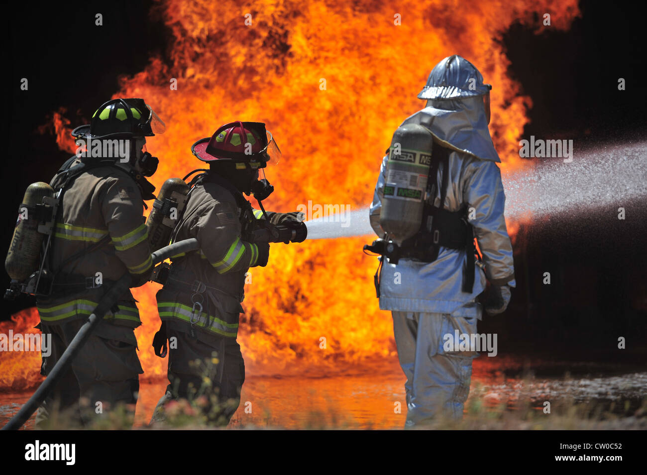 Firefighters with the Clovis, N.M. Fire Department and a firefighter with the 27th Special Operations Civil Engineer - Stock Image