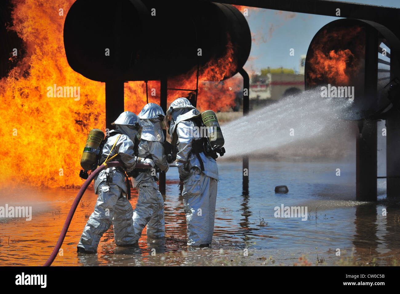 Firefighters with the 27th Special Operations Civil Engineer Squadron work to extinguish an engine fire in the burn - Stock Image