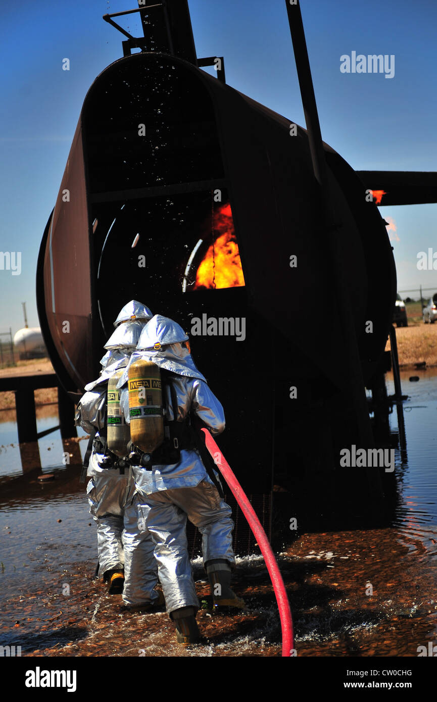 Firefighters with the 2th Special Operations Civil Engineer Squadron enter the burn pit at Cannon Air Force Base, - Stock Image