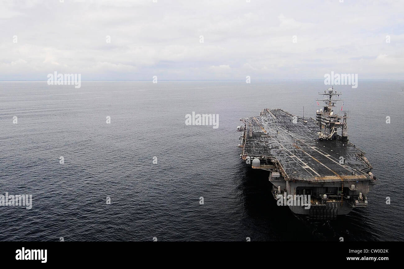 The aircraft carrier USS Abraham Lincoln (CVN 72) prepares to arrive at it's new homeport at Naval Station Norfolk. - Stock Image