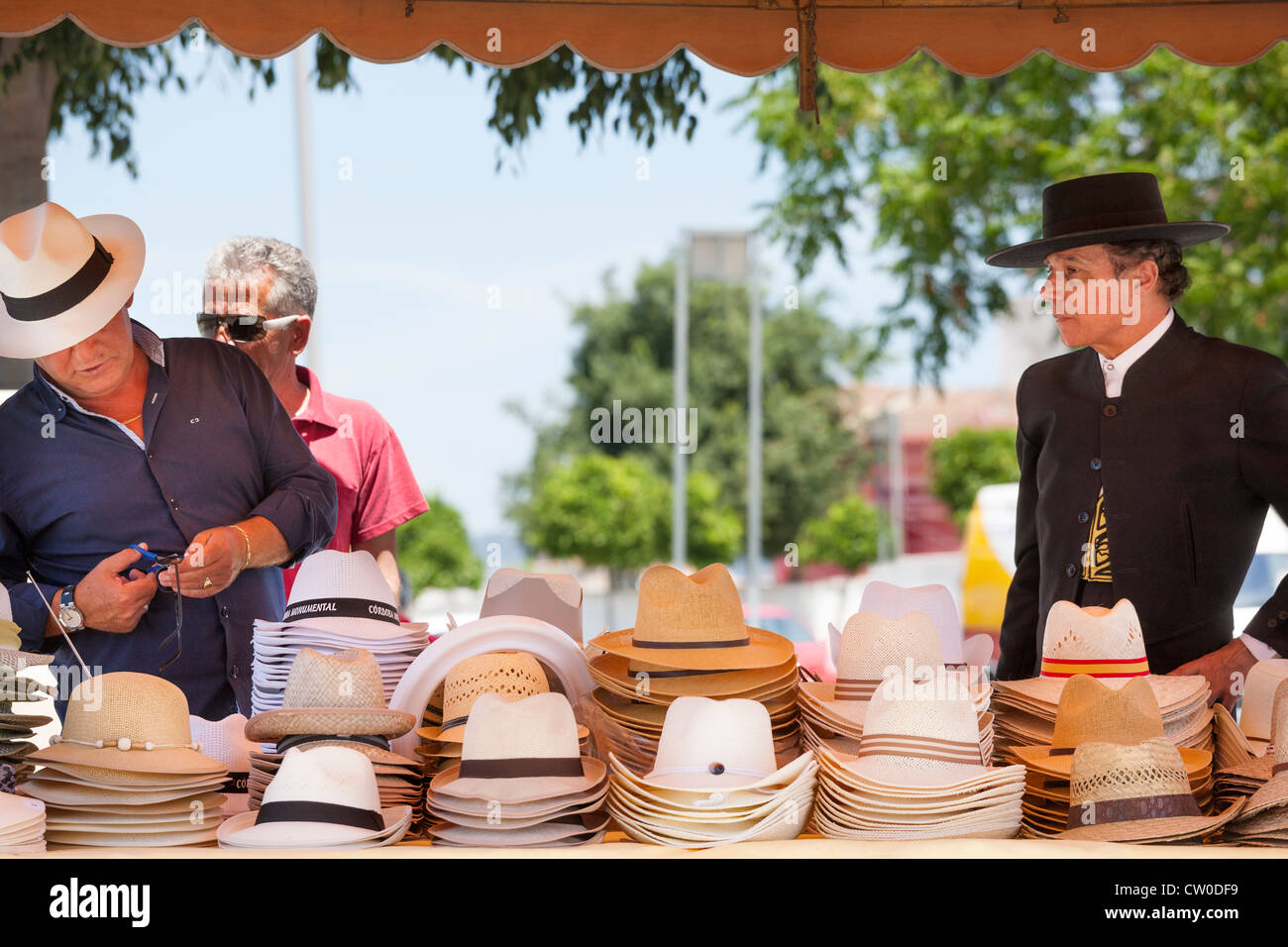 Market stall in Cordoba Andalusia Andalucia Spain.Hatter selling modern and traditional man's hats. - Stock Image