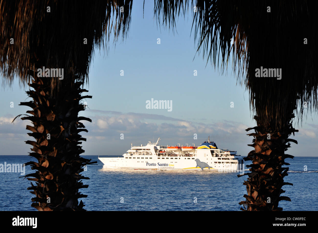 Portugal - Madeira - Funchal - white ferry boat to Porto Santo island - off Madeira - catching early sunlight  framed - Stock Image