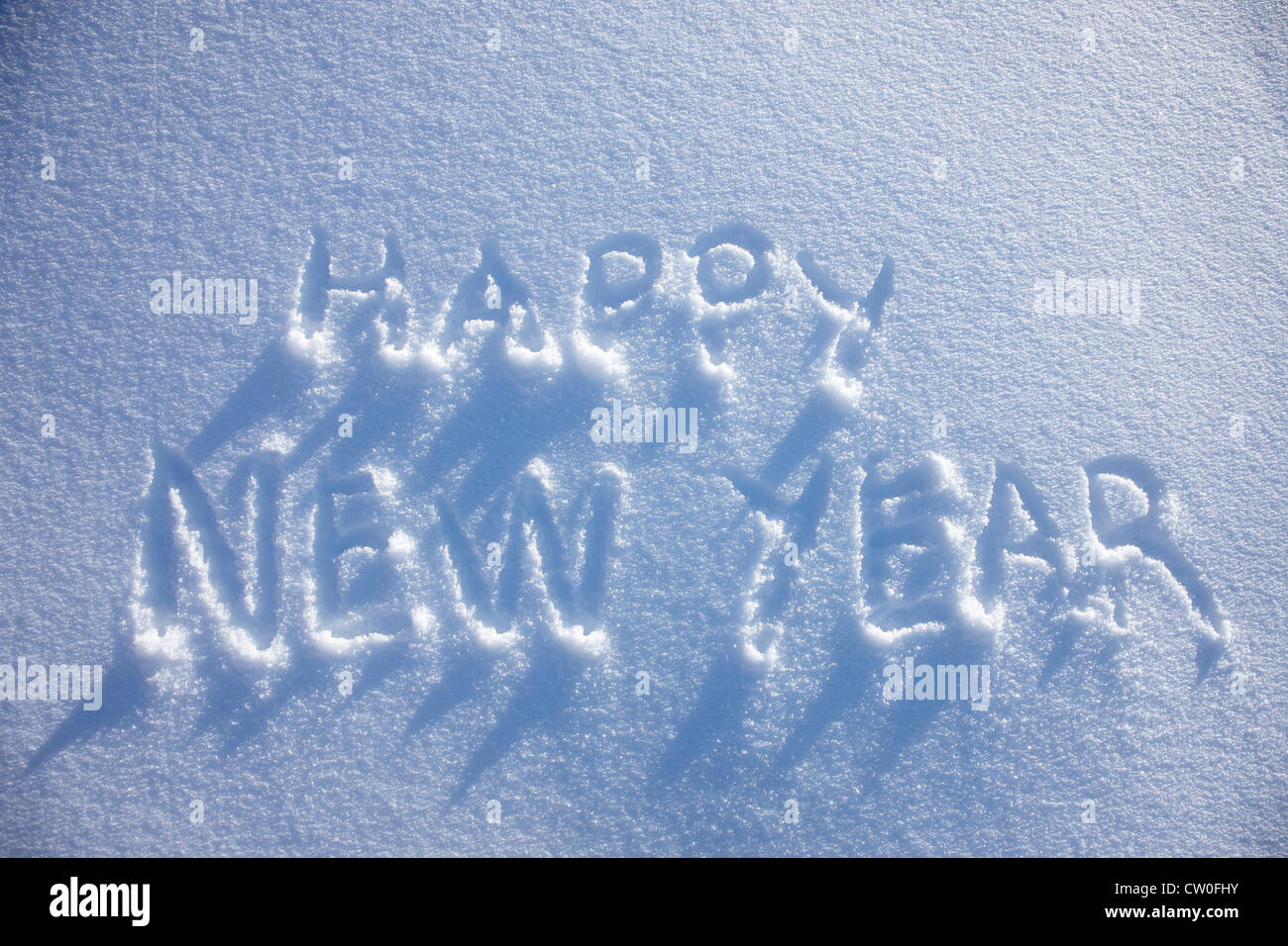 Happy New Year written in snow - Stock Image