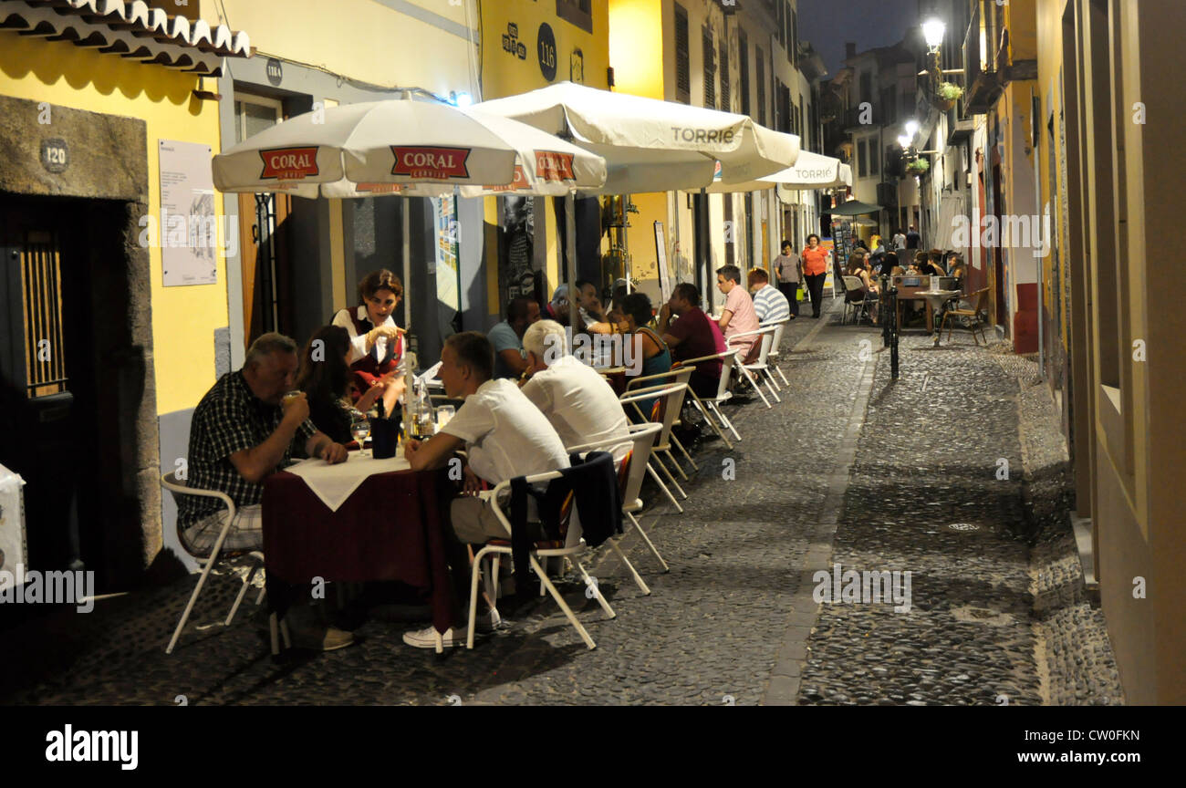 Portugal - Madeira - Funchal Zona Velha - the old town - evening on the Rue Santa Maria - diners under the street - Stock Image