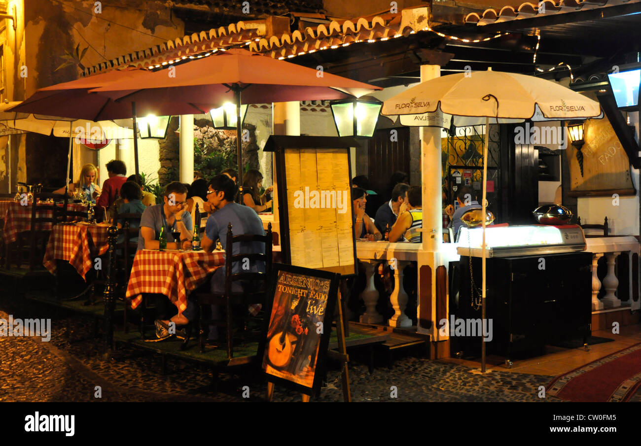 Portugal - Madeira - Funchal - Zona Velha - restaurant and diners - seen late evening - under the stars and back - Stock Image