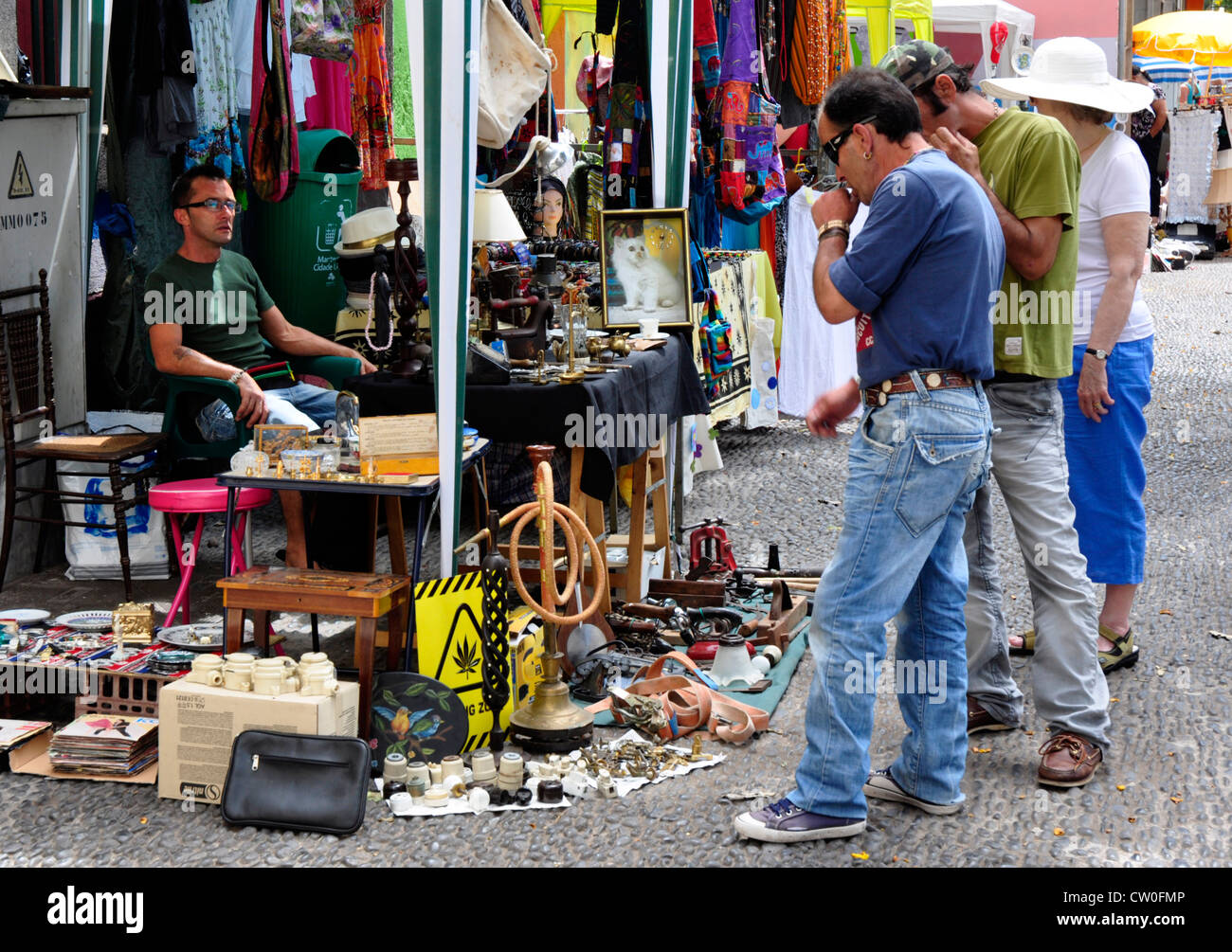 Portugal - Madeira - Funchal Zona velha - stall in street market - buyers contemplating a possible purchase - Stock Image