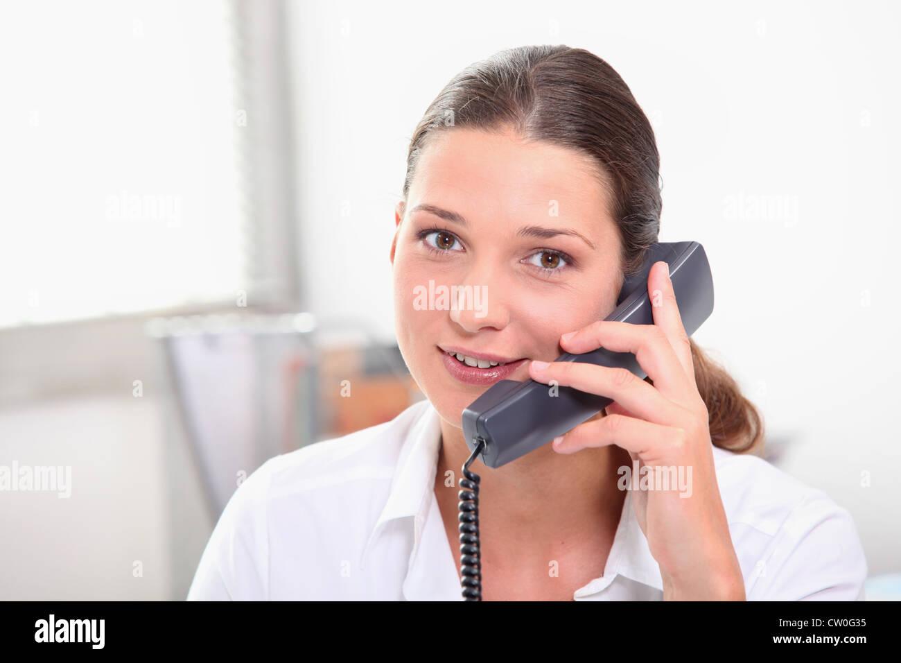 Secretary with telephone - Stock Image