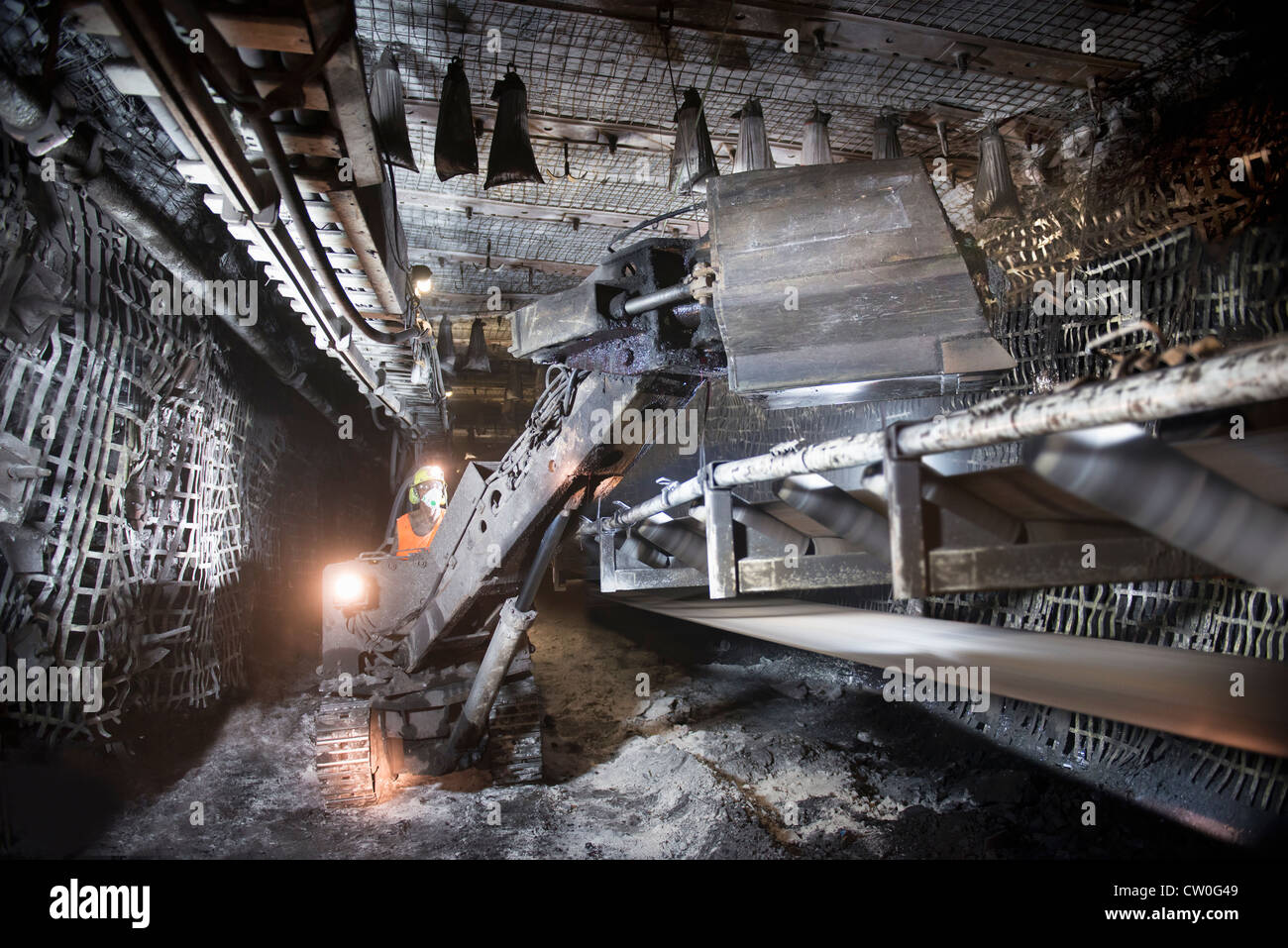 Coal miner working in mine Stock Photo