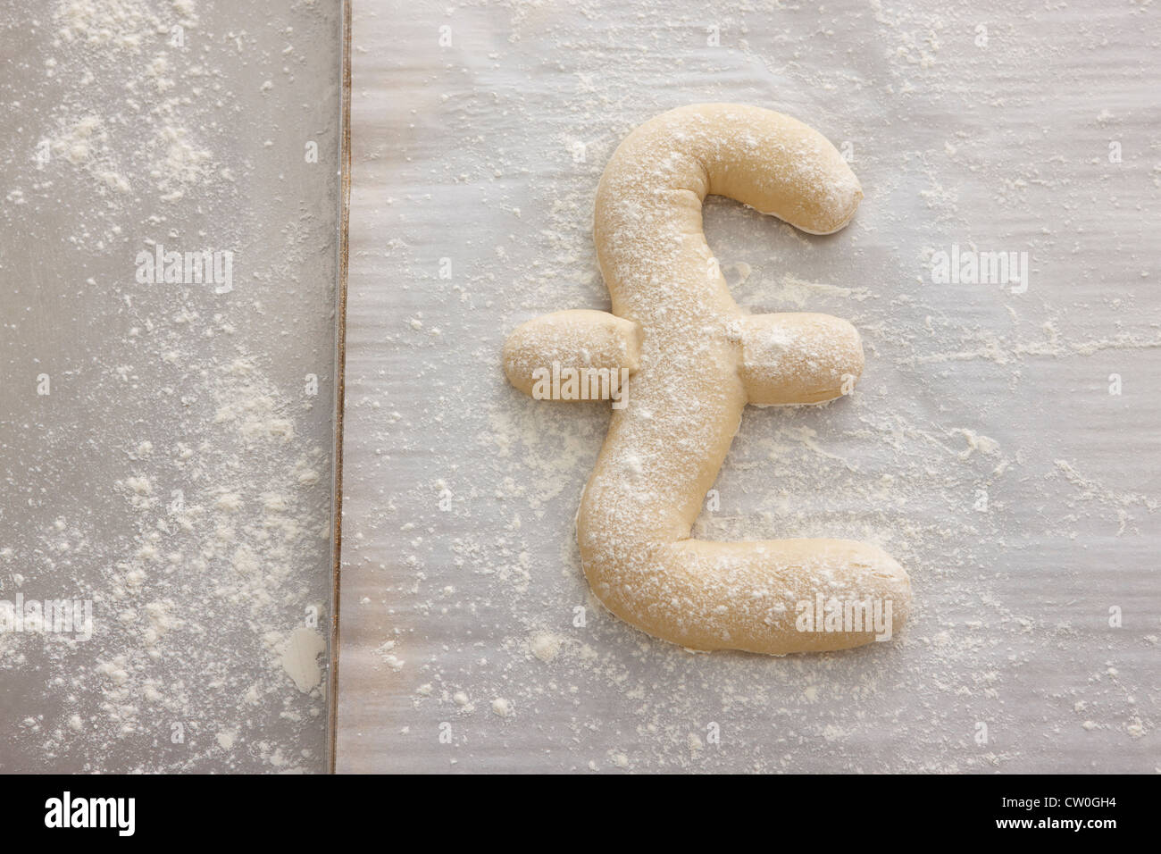 Bread dough shaped in pound symbol - Stock Image