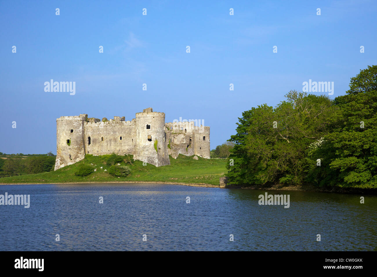 Carrew ruined castle in  spring sunshine Pembrokeshire National Park, West Wales, Cymru, UK, United Kingdom, GB - Stock Image