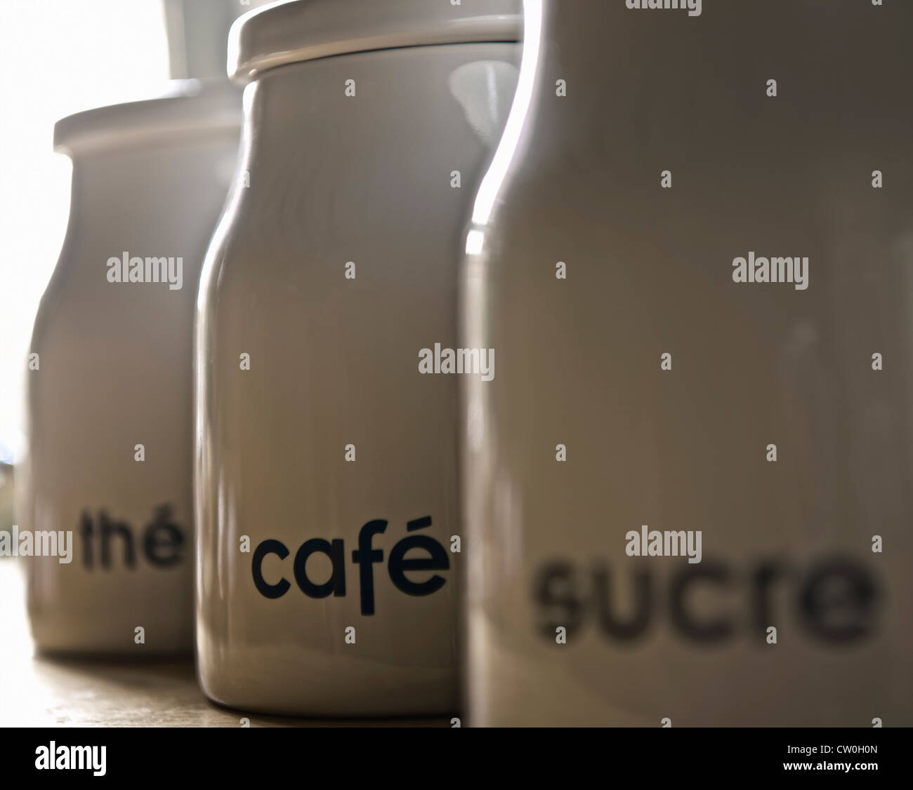 Close up of coffee, tea and sugar jars - Stock Image