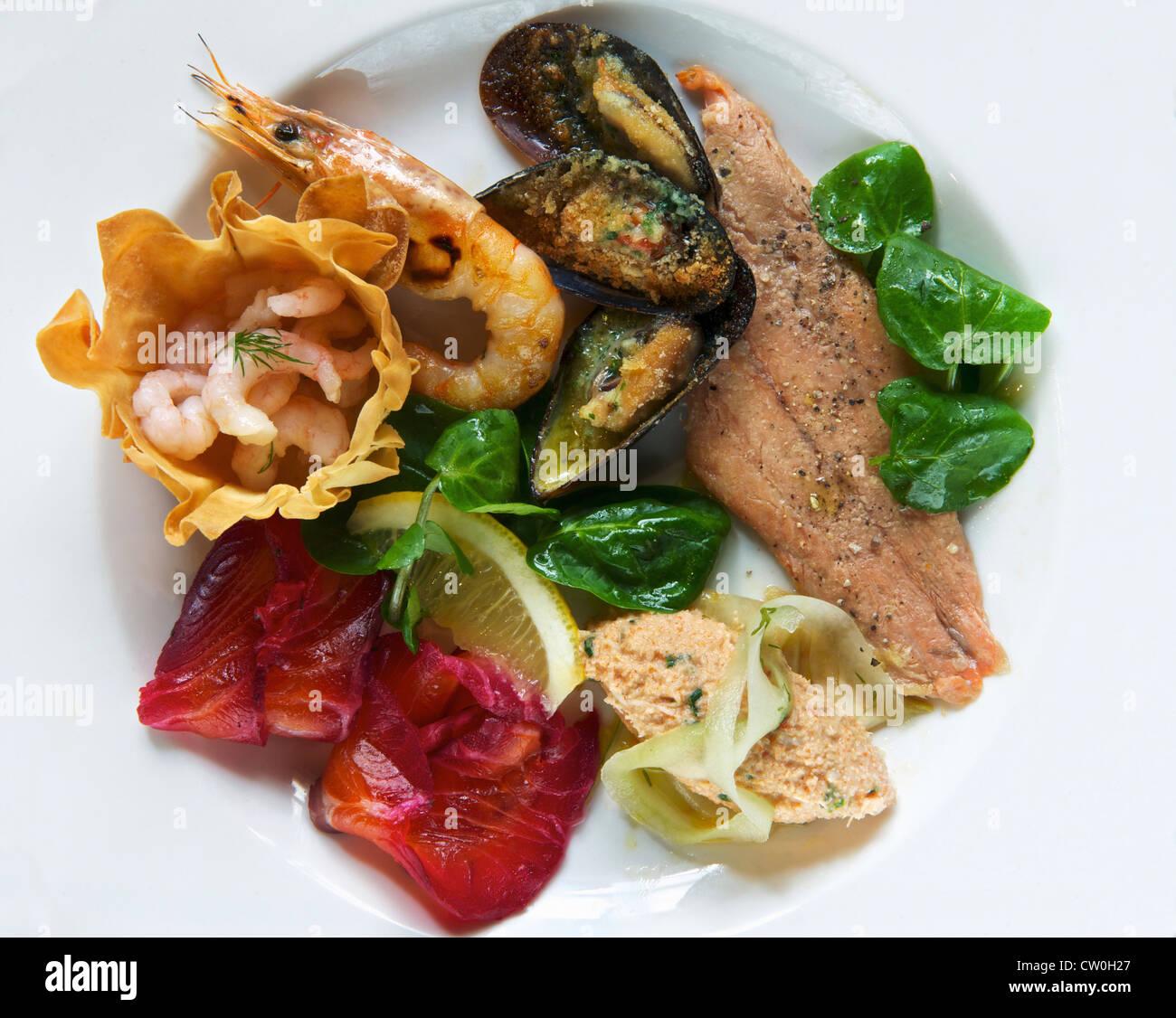 Plate of smoked seafood - Stock Image