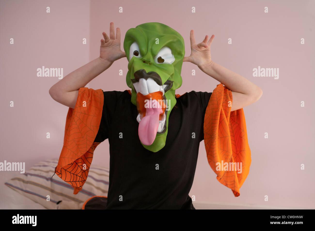 Child grimacing in Halloween costume - Stock Image