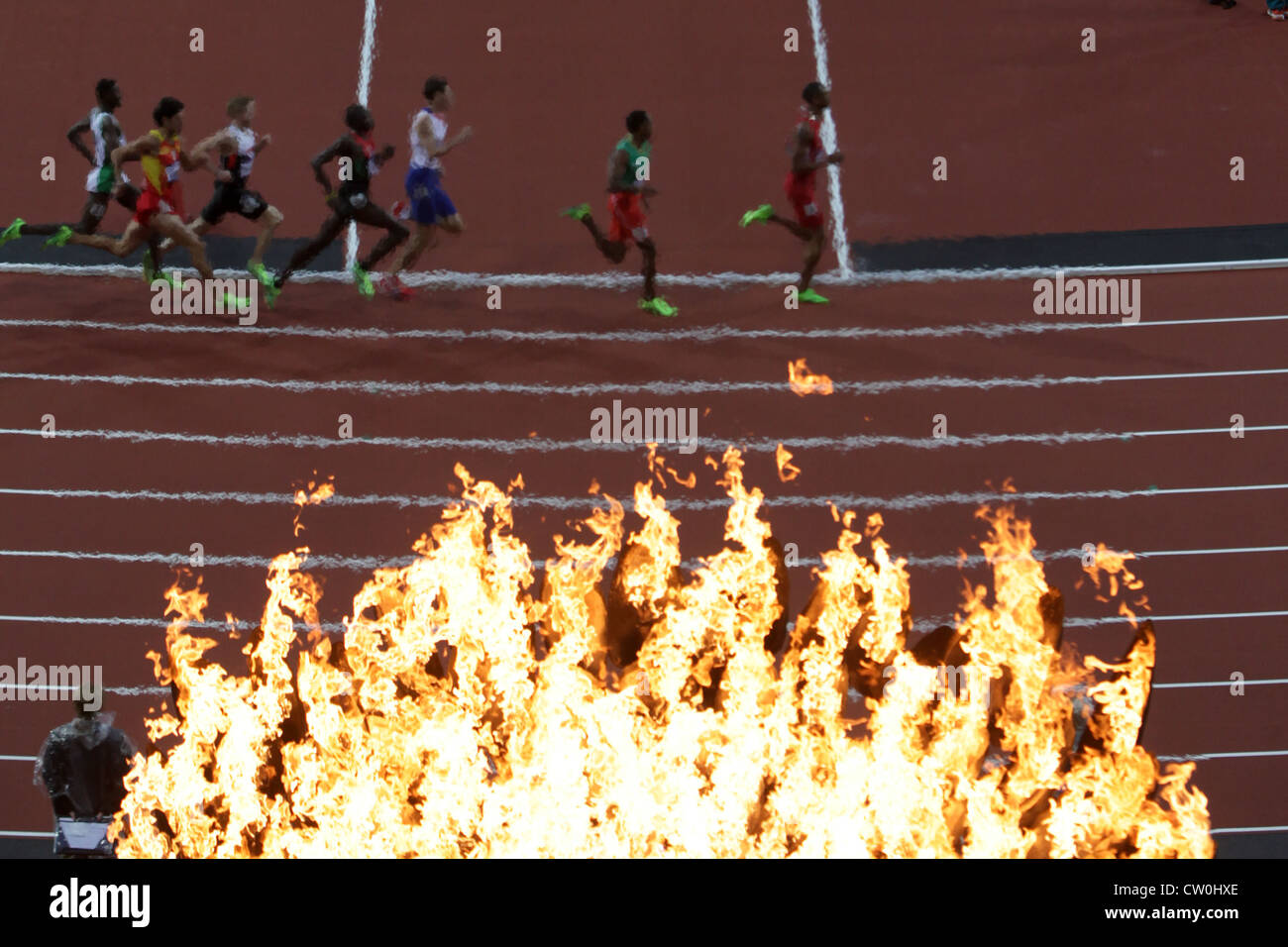 THE OLYMPIC FLAME AT THE STADIUM IN LONDON 2012 - Stock Image