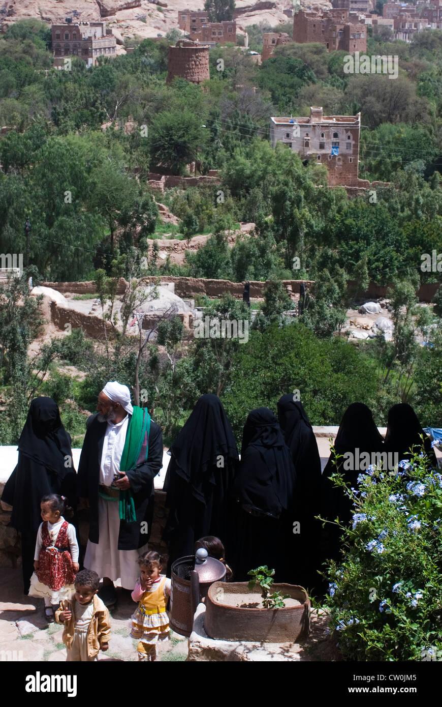 People in the Dar Al Hajar the rock palace in Wadi Dhahr, Yemen, Western Asia, Arabian Peninsula. - Stock Image
