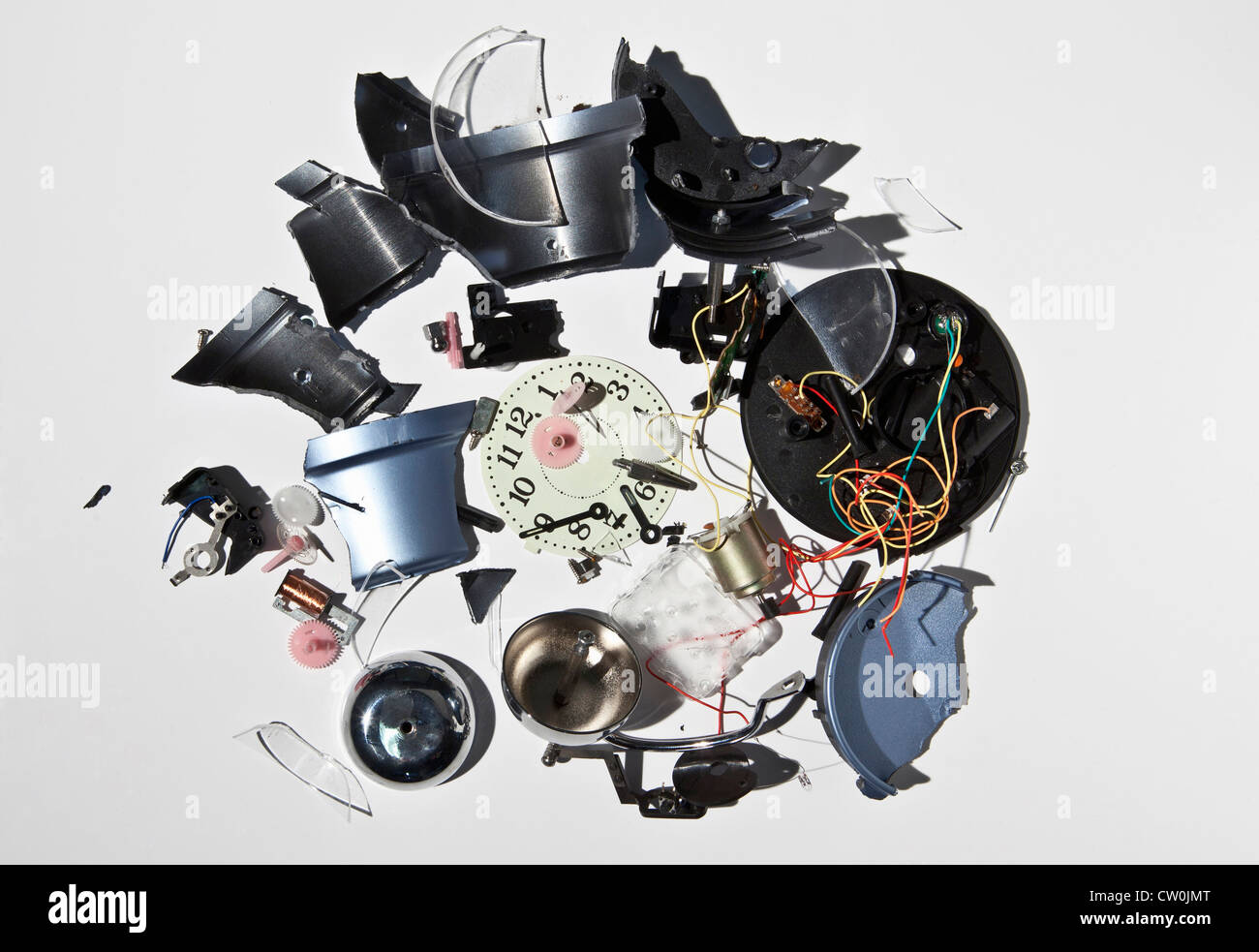 Pile of smashed clock parts - Stock Image